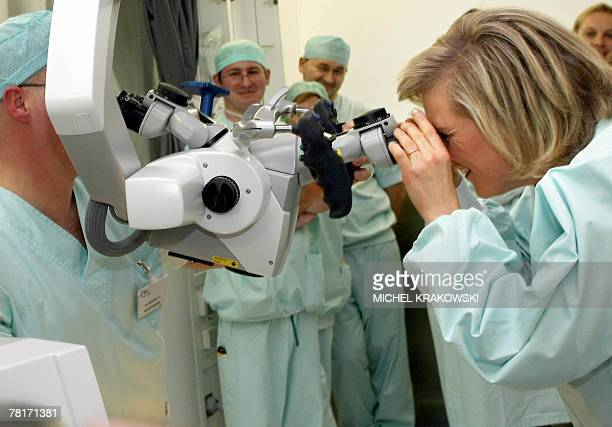 Princess Astrid of Belgium looks into the IRM microscope during a visit at the CHU hospital in Liege 30 November 2007 on the occasion of the...