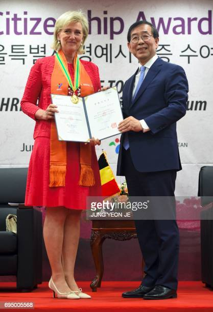 Princess Astrid of Belgium poses with Seoul Mayor Park WonSoon during a ceremony of honorary citizenship award in Seoul on June 12 2017 Princess...