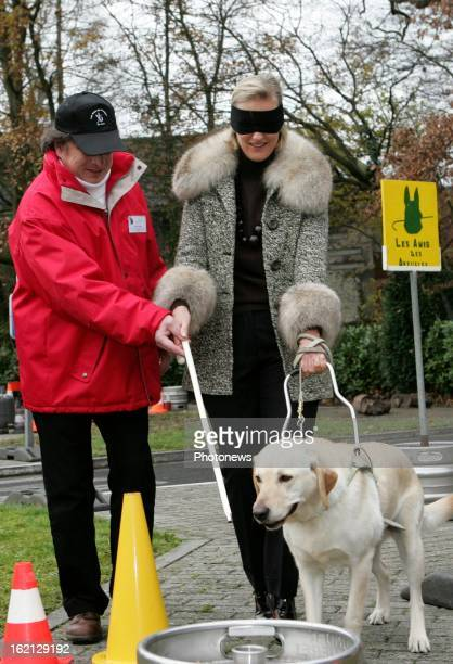 Princess Astrid of Belgium visiting a Center for Blind People where guide dogs are being trained