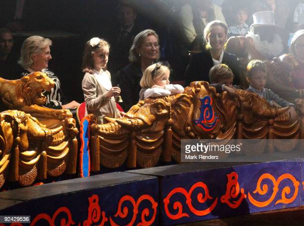 Princess Astrid Princess Laetitia Maria Princess Louise Prince Nicolas Prince Aymeric and Queen Paola and Princess Claire of Belgium attend a show at...