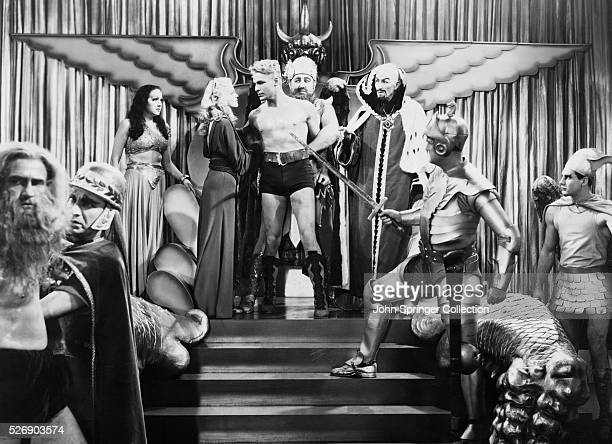 Princess Aura Dale Arden Flash Gordon Dr Zarkov and Emperor Ming standing in front of Mongo subjects