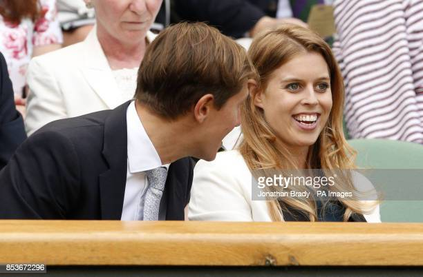 Princess Beatrice and her boyfriend David Clark in the Royal Box on Centre Court during day ten of the Wimbledon Championships at the All England...