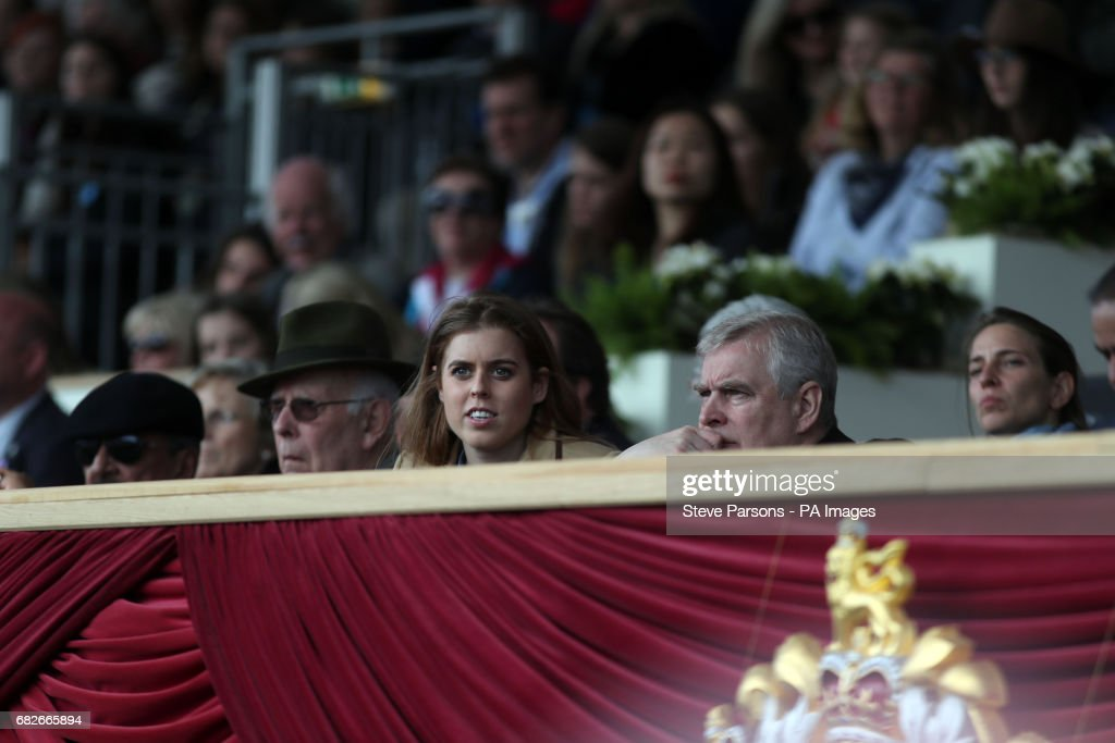 Princess Beatrice and her father the Duke of York (centre right) during the Royal Windsor Horse Show, which is held in the grounds of Windsor Castle in Berkshire.