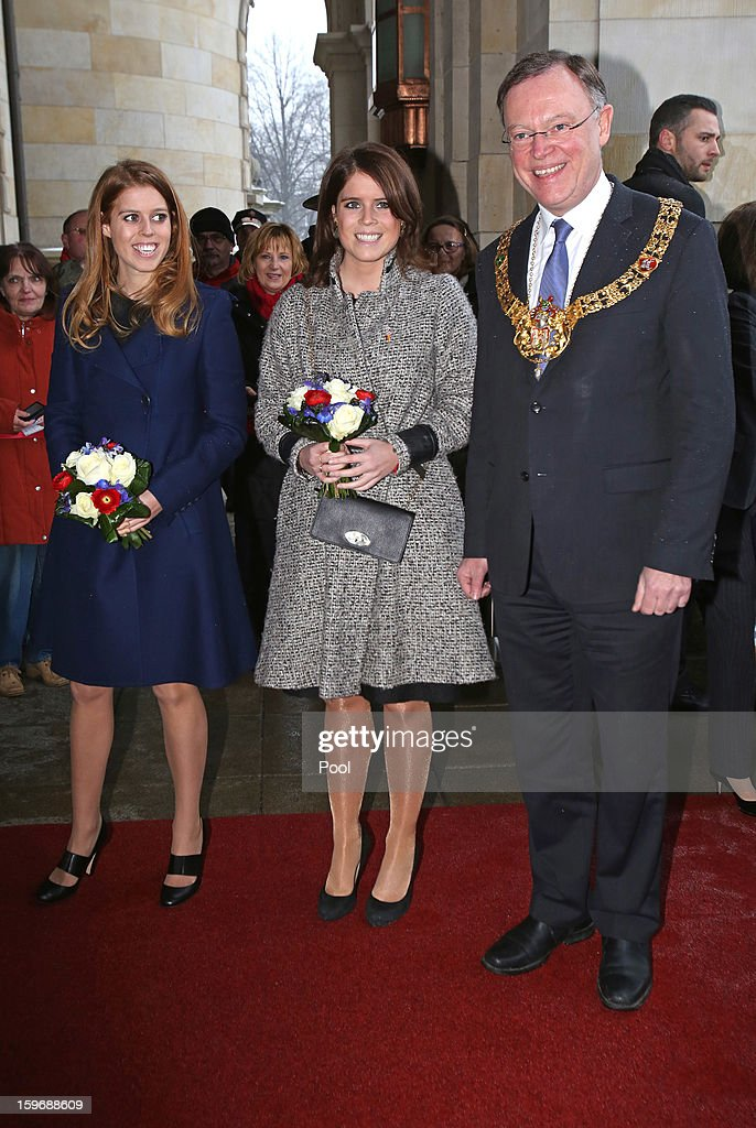 Princess Beatrice and Princess Eugenie are greeted by The Mayor of Hanover Stephan Weil as they arrive at Hanover City Hall on January 18, 2013 in Hanover, Germany. The royal sisters are in Hanover on the second day of a two day visit to Germany.Yesterday the royals were in Berlin helping support GREAT, the British Government's initiative promoting the UK abroad.