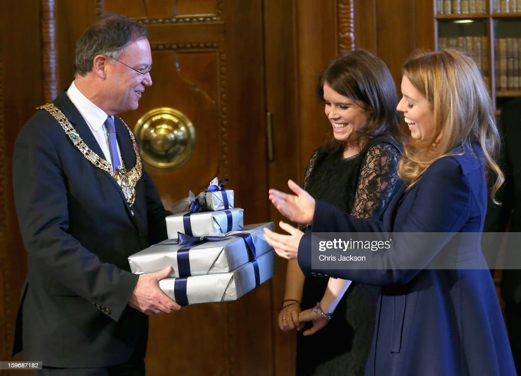 Princess Beatrice and <a gi-track='captionPersonalityLinkClicked' href=/galleries/search?phrase=Princess+Eugenie&family=editorial&specificpeople=160237 ng-click='$event.stopPropagation()'>Princess Eugenie</a> are presented with gifts by Mayor of Hanover Stephan Weil at Hanover City Hall on January 18, 2013 in Hanover, Germany. The royal sisters are in Hanover on the second day of a two day visit to Germany.Yesterday the royals were in Berlin helping support GREAT, the British Government's initiative promoting the UK abroad.