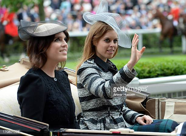 Princess Beatrice and Princess Eugenie arrive in an open carriage during Day 1 of Royal Ascot at Ascot Racecourse on June 18 2013 in Ascot England