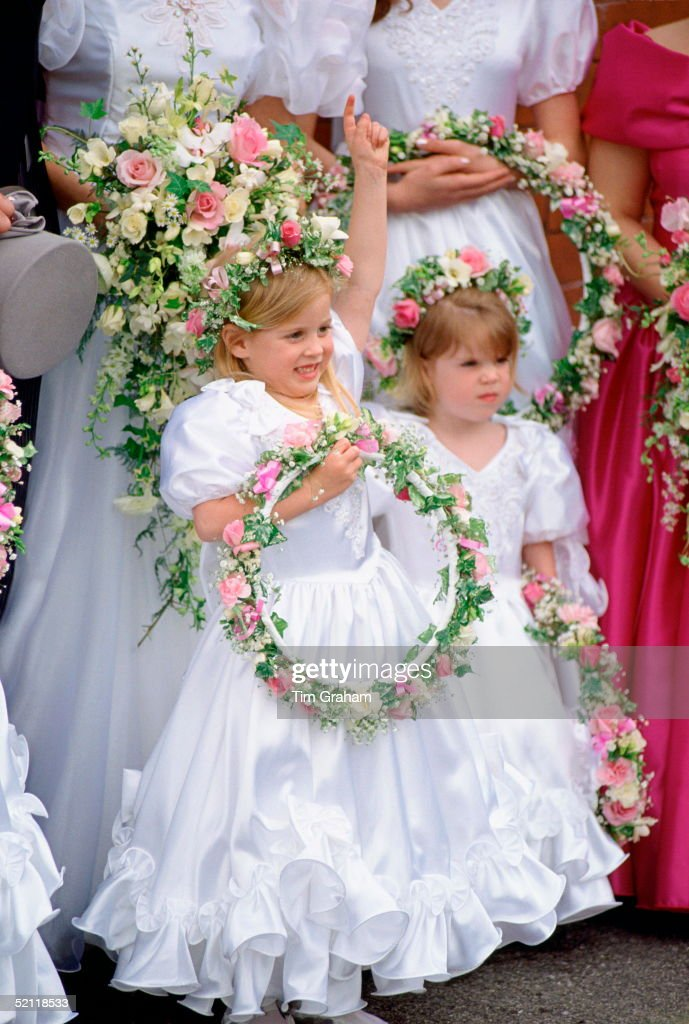 Sisters Princess Beatrice and Princess Eugenie wore pretty little white dresses as bridesmaids for their former nanny Alison Wardley as she married Royal police bodyguard Ben Dady. Photo: Tim Graham