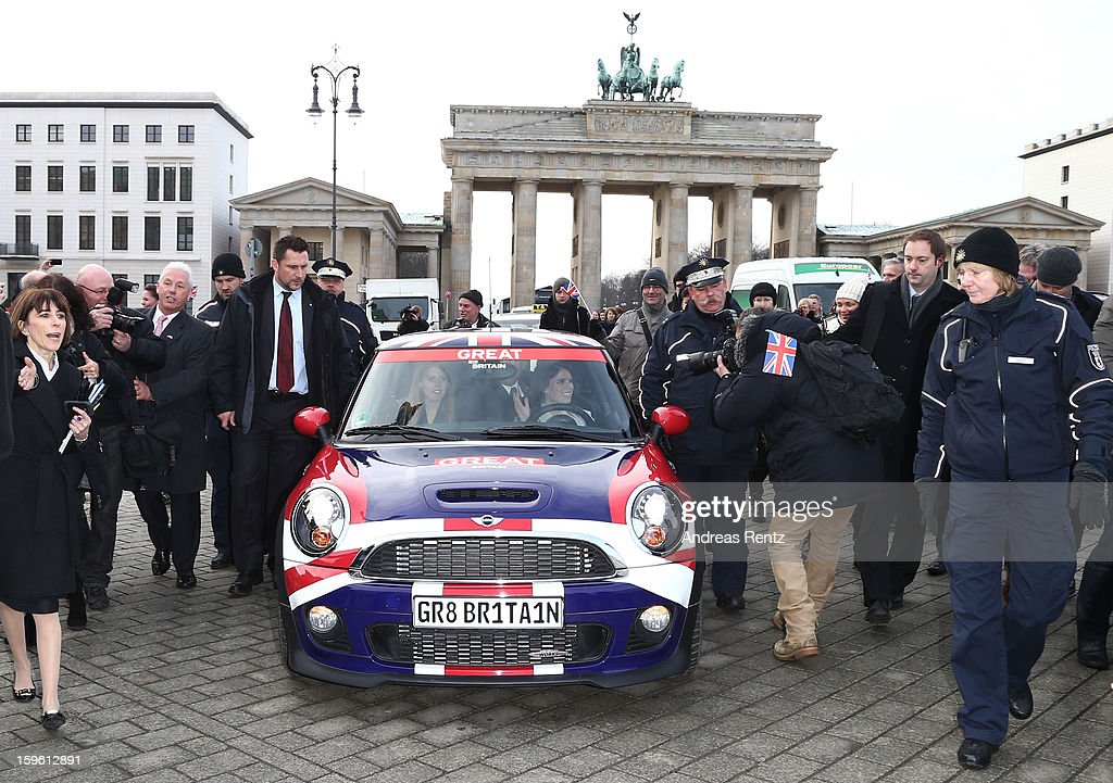 Princess Beatrice and Princess Eugenie drive a Mini in front of Brandenburg Gate as she promotes the GREAT initiative on January 17, 2013 in Berlin, Germany. The royal sisters are in Berlin as supporting the governments GREAT initiative promoting the UK abroad. They will visit Hanover tommorow as part of this two day trip funded by their father the Duke of York.