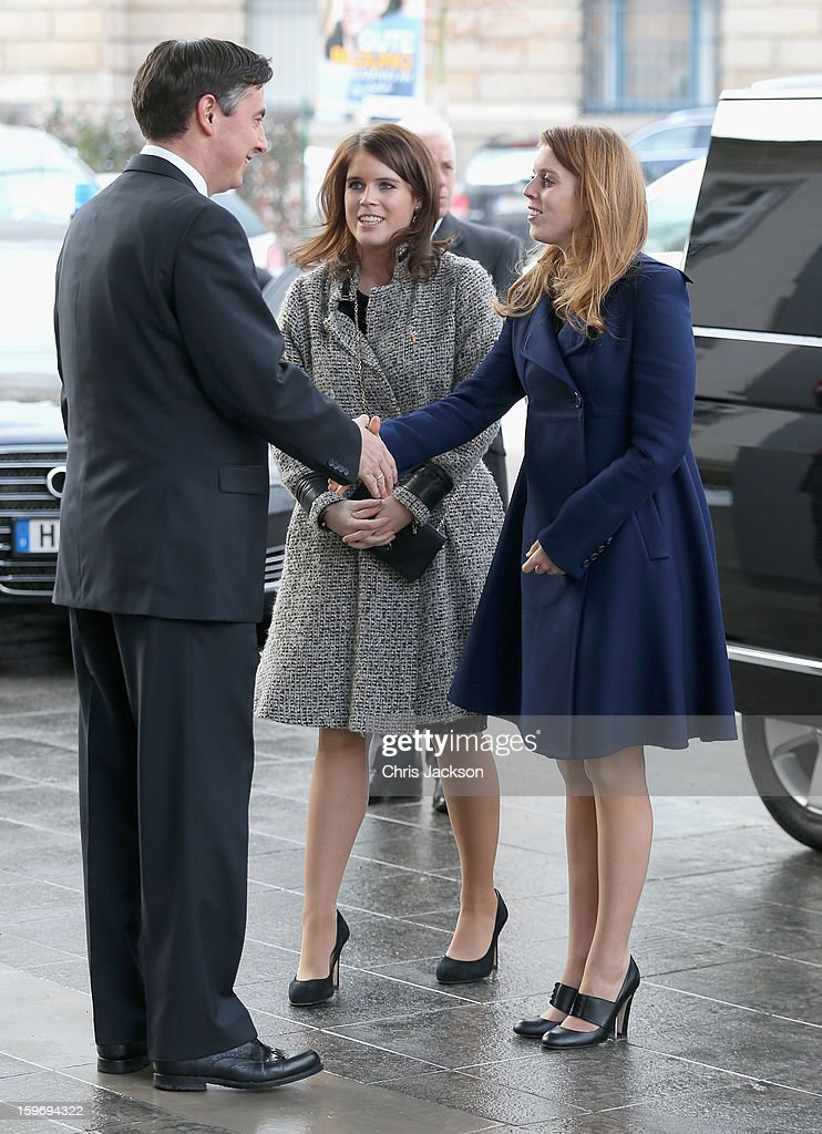 Princess Beatrice (R) and Princess Eugenie (C) greet David McAllister as they arrive to call on Minister David McAllister of Lower Saxony on January 18, 2013 in Hanover, Germany. The royal sisters are in Hanover on the second day of a two day visit to Germany.Yesterday the royals were in Berlin helping support GREAT, the British Government's initiative promoting the UK abroad.