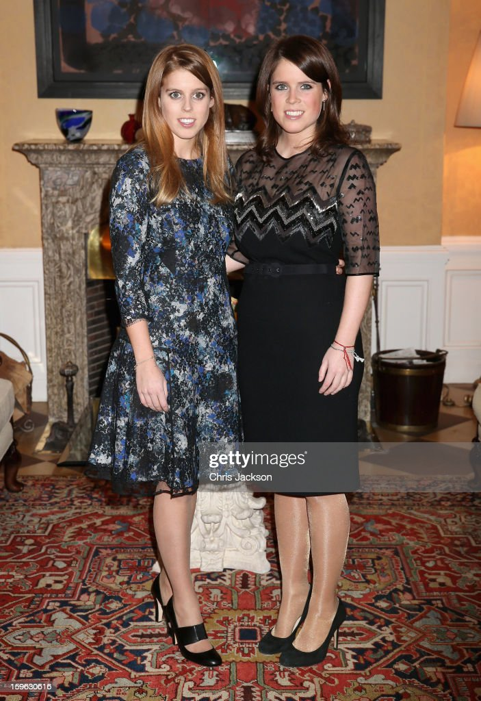 Princess Beatrice (L) and Princess Eugenie of York pose for a photograph at the British Ambassador's Residence on January 17, 2013 in Berlin, Germany. The royal sisters are in Berlin to support the government's GREAT initiative promoting the UK abroad. They will visit Hanover tommorow as part of this two day trip funded by their father the Duke of York.