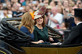 Princess Beatrice and Princess Eugenie sit in a carriage during the Trooping the Colour this year marking the Queen's 90th birthday at The Mall on...