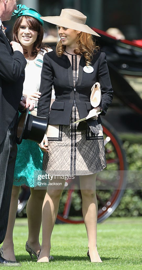 Princess Beatrice and Princess Eugenie (L) walk in the parade ring on the opening day of Royal Ascot at Ascot Racecourse on June 14, 2011 in Ascot, United Kingdom.