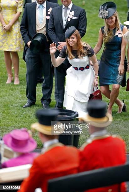 Princess Beatrice curtsies to Queen Elizabeth II as she drives past in her horse drawn carriage on day 5 of Royal Ascot at Ascot Racecourse on June...