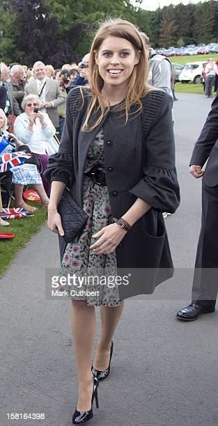 Princess Beatrice Greets The Olympic Torch At Harewood House Near Leeds