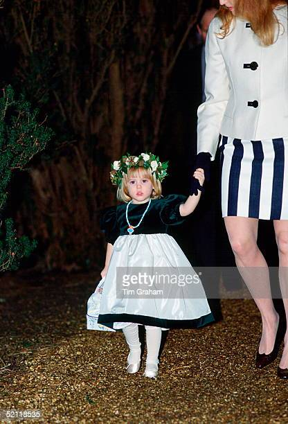 Princess Beatrice In A Bridesmaid's Outfit Holding Her Mother's Hand As They Attend The Wedding Of Lulu Blacker Who Is A Close Friend Of Susan...