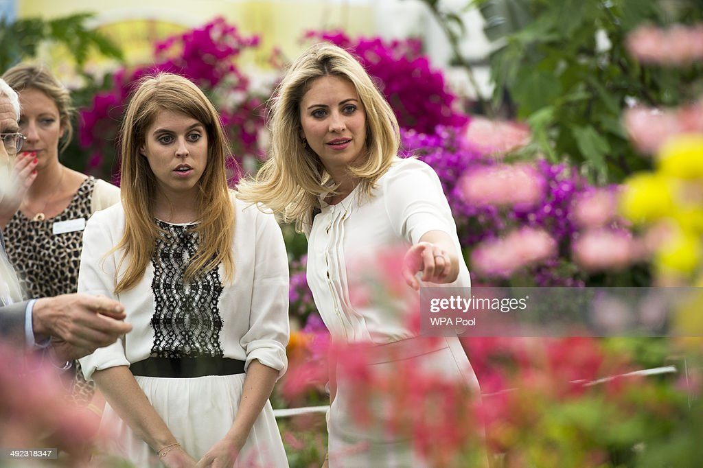 Princess Beatrice of York and friend Holly Branson during a visit to the Chelsea Flower Show on press day on May 19, 2014 in London, England.