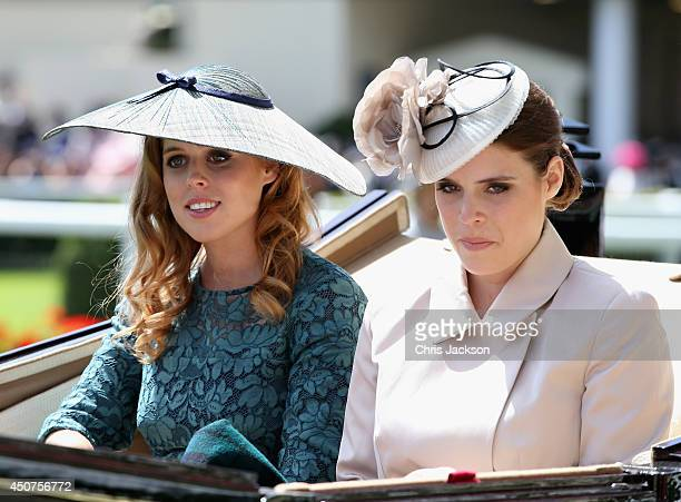 Princess Beatrice of York and Princess Eugenie of York attend day one of Royal Ascot at Ascot Racecourse on June 17 2014 in Ascot England