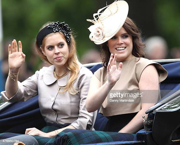 Princess Beatrice of York and Princess Eugenie of York wave at the crowd during the annual Trooping The Colour ceremony at Horse Guards Parade on...