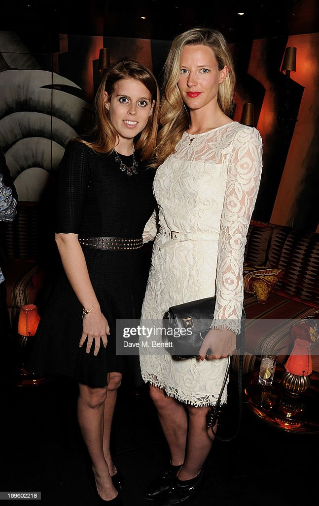 Princess Beatrice of York (L) attend the launch of 'The New Digital Age: Reshaping The Future Of People, Nations and Business' by Eric Schmidt and Jared Cohen, hosted by Jamie Reuben, at Loulou's on May 28, 2013 in London, England.