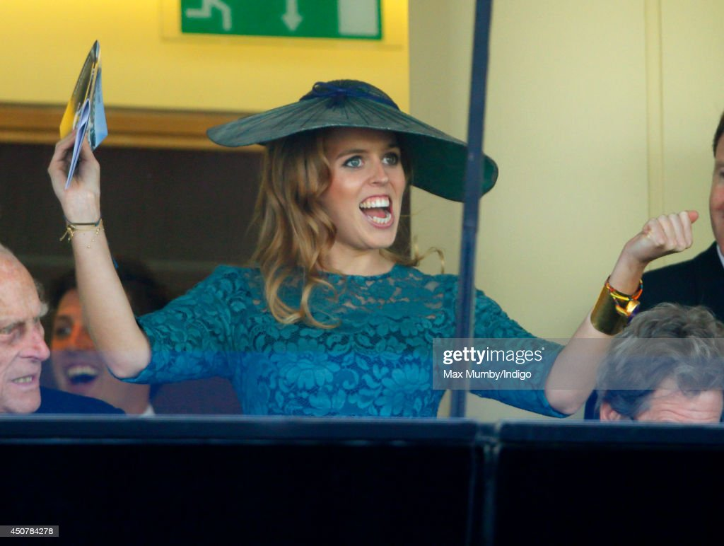 Princess Beatrice of York cheers whilst watching the racing as she attends Day 1 of Royal Ascot at Ascot Racecourse on June 17, 2014 in Ascot, England.