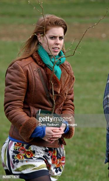 Princess Beatrice of York holds a hazel tree saplings during a visit to The Woodland Trust at Heartwood Forest at Sandridge near St Albans...