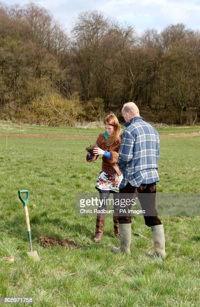 Princess Beatrice of York inspects hazel tree saplings alongside John Tucker Operations Director of The Woodland Trust during a visit to The Woodland...