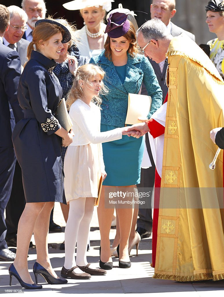 Princess Beatrice of York, Lady Louise Windsor and Princess Eugenie of York talk with The Very Reverend Dr John Hall (Dean of Westminster) as they attend a service of celebration to mark the 60th anniversary of the Coronation of Queen Elizabeth II at Westminster Abbey on June 4, 2013 in London, England. The Queen's Coronation took place on June 2, 1953 after a period of mourning for her father King George VI, following her ascension to the throne on February 6, 1952. The event 60 years ago was the first time a coronation was televised for the public.