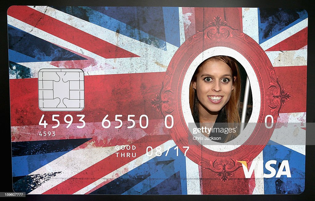 Princess Beatrice of York peers through a giant credit card as she visits e-commerce company 'Zalando' during a visit to the city with her sister on January 17, 2013 in Berlin, Germany. The royal sisters are in Berlin supporting the government's GREAT initiative, promoting the UK abroad. They will visit Hanover tomorow as part of a two-day trip funded by their father the Duke of York.