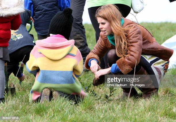 Princess Beatrice of York plants tree saplings with children from Highfields Primary School Enfield during a visit to The Woodland Trust at Heartwood...