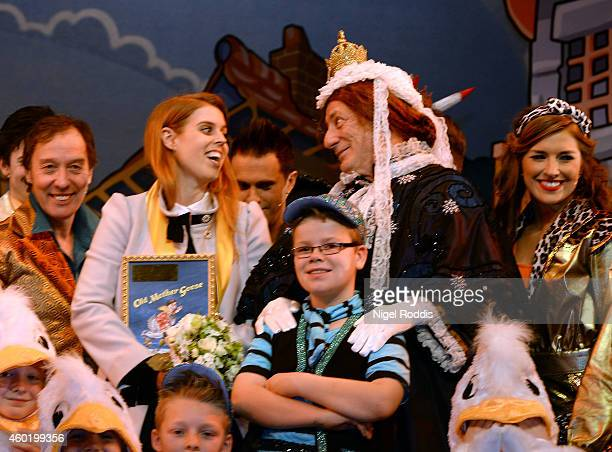 Princess Beatrice of York poses for photographs with cast members of Old Mother Goose pantomime at York Royal Theatre on December 9 2014 in York...