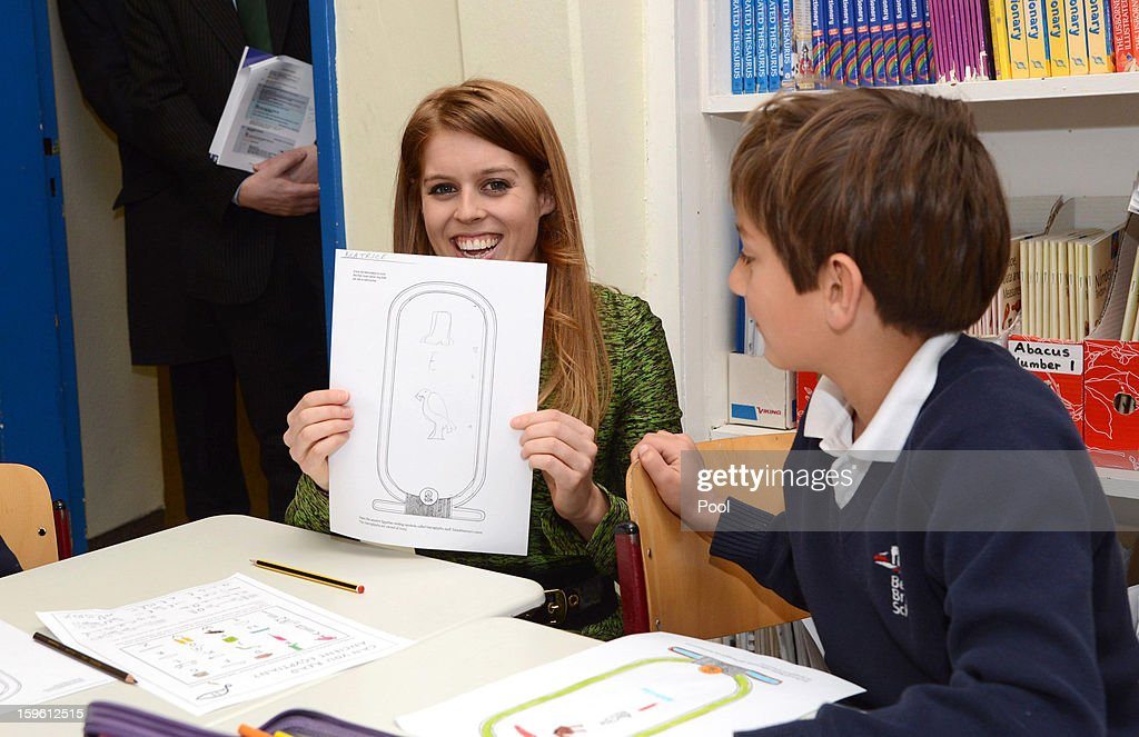 Princess Beatrice of York poses with a drawing of her name written in Hieroglyphics during a visit to the British School in Berlin on January 17, 2013 in Berlin, Germany. The royal sisters are in Berlin supporting the government's GREAT initiative, promoting the UK abroad. They will visit Hanover tomorow as part of a two-day trip funded by their father the Duke of York.