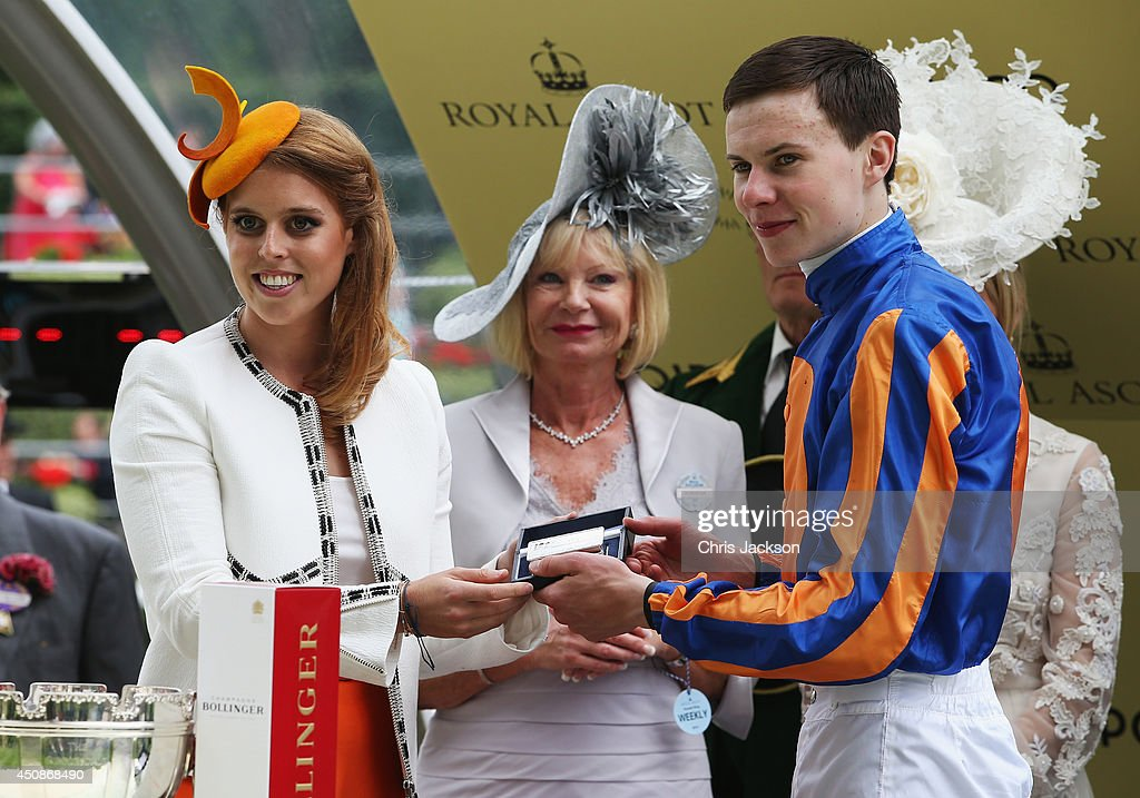 <a gi-track='captionPersonalityLinkClicked' href=/galleries/search?phrase=Princess+Beatrice+of+York&family=editorial&specificpeople=531999 ng-click='$event.stopPropagation()'>Princess Beatrice of York</a> presents the Jockeys' prize for the Gold Cup race to <a gi-track='captionPersonalityLinkClicked' href=/galleries/search?phrase=Joseph+O%27Brien+-+Jockey&family=editorial&specificpeople=12884576 ng-click='$event.stopPropagation()'>Joseph O'Brien</a> during day three of Royal Ascot at Ascot Racecourse on June 19, 2014 in Ascot, England.