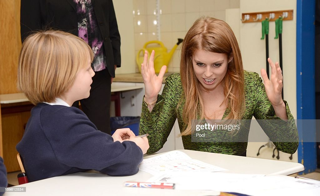 Princess Beatrice of York speaks with a pupil during a visit to the British School in Berlin on January 17, 2013 in Berlin, Germany. The royal sisters are in Berlin supporting the government's GREAT initiative, promoting the UK abroad. They will visit Hanover tomorow as part of a two-day trip funded by their father the Duke of York.