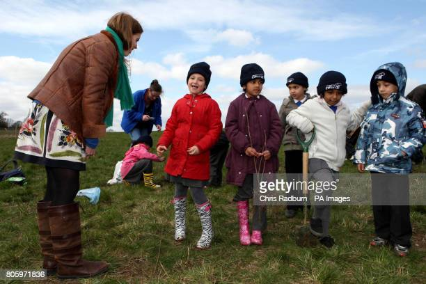 Princess Beatrice of York talks with children from Highfields Primary School Enfield during a visit to The Woodland Trust at Heartwood Forest at...