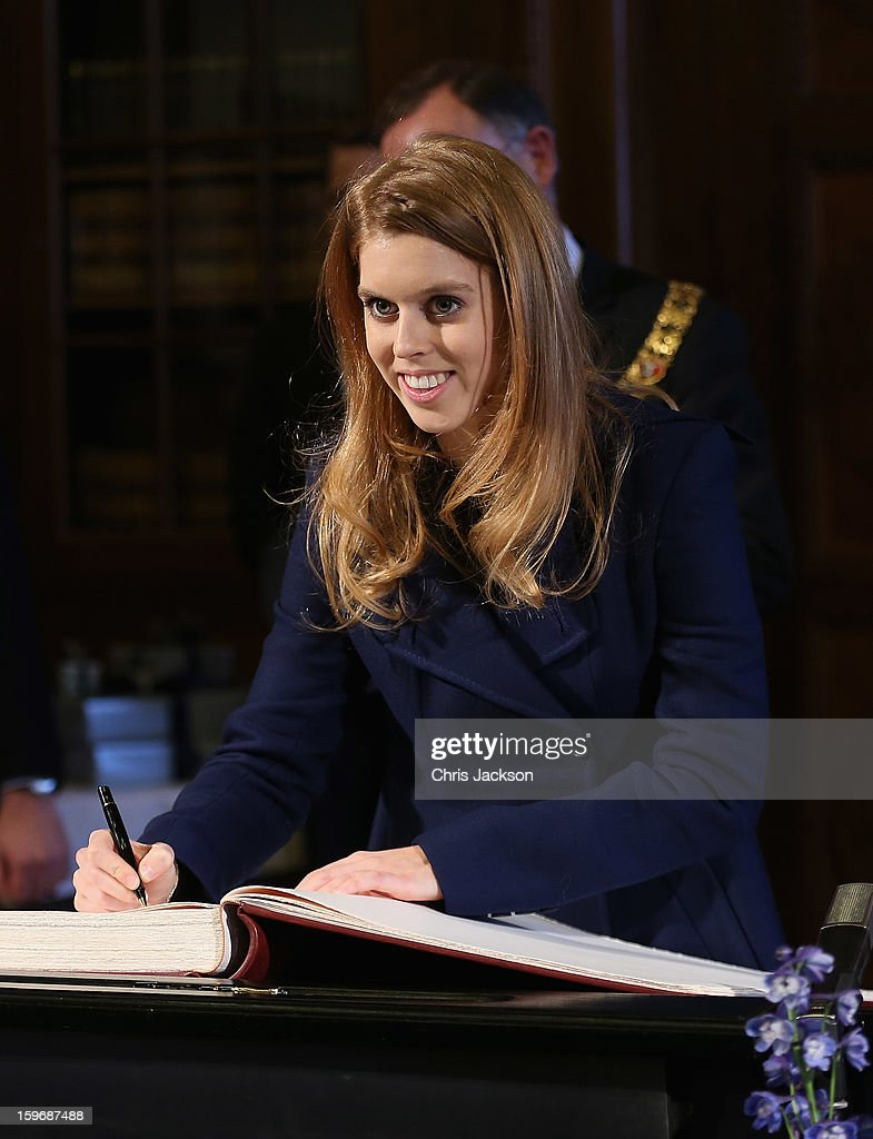 Princess Beatrice signs the Golden Book at Hanover City Hall on January 18, 2013 in Hanover, Germany. The royal sisters are in Hanover on the second day of a two day visit to Germany.Yesterday the royals were in Berlin helping support GREAT, the British Government's initiative promoting the UK abroad.