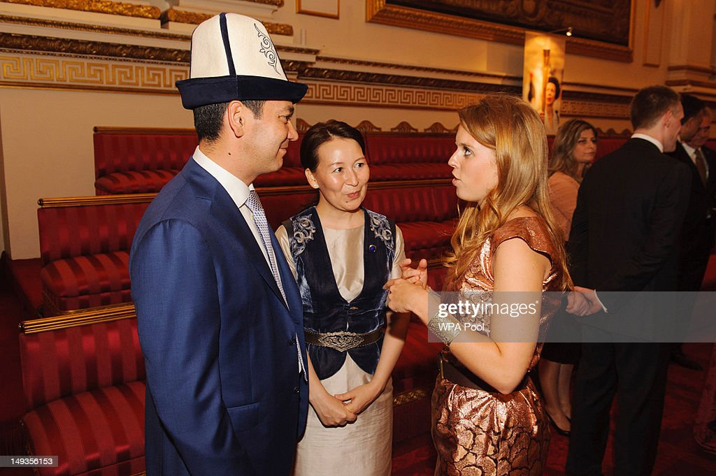 Princess Beatrice (R) speaks to the Prime Minister of Kyrgyzstan Omurbek Babanov (L) and Rita Birbaeva during a reception at Buckingham Palace a reception for Heads of State and Government attending the Olympics Opening Ceremony on July 27, 2012 in London, England.