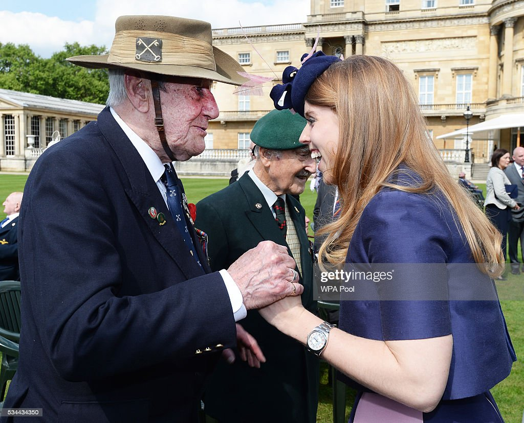 Princess Beatrice talks to a guest at the the annual Not Forgotten Association Garden Party, hosted by her father, The Duke of York at Buckingham Palace on May 26, 2016 in London, England.