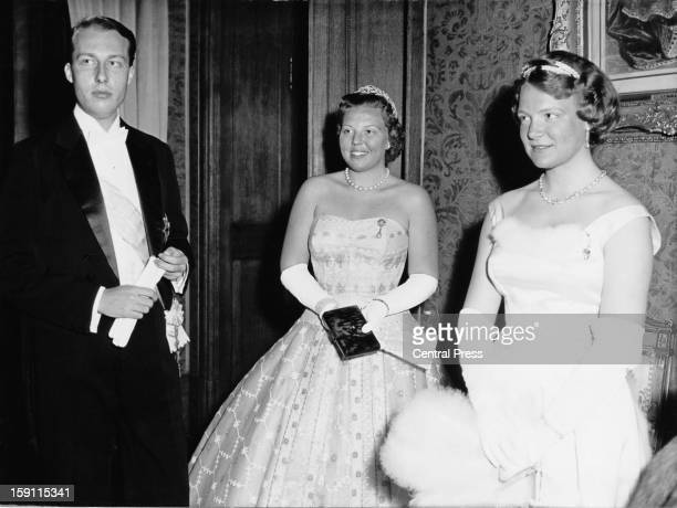 Princess Beatrix later Queen Beatrix of the Netherlands with her sister Princess Irene at a court ball at the royal palace in Brussels Belgium 19th...