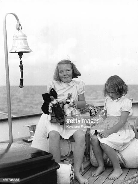 Princess Beatrix left with her sister Princess Irene playing with their dolls on a boat deck on September 9 1946 in Netherlands