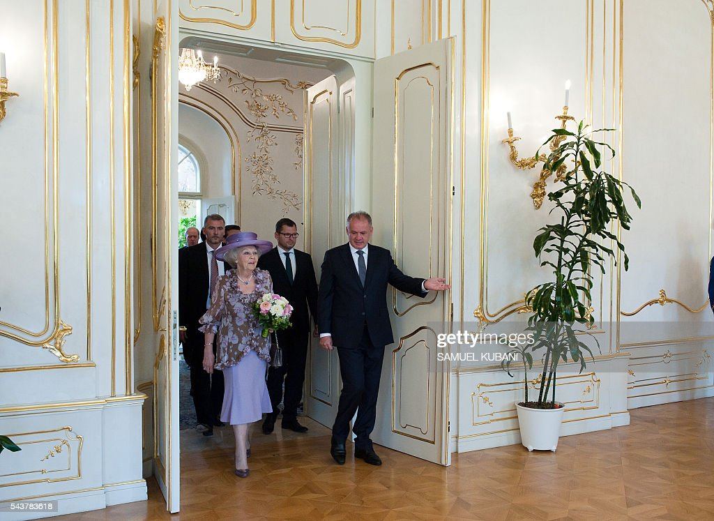 Princess Beatrix of The Netherlands (L) and Slovak President Andrej Kiska arrive for their meeting at the presidential palace in Bratislava on June 30, 2016. Netherland's hands over to Slovakia the rotating six-month Presidency of the European Union Councilof on July 1, 2016. / AFP / SAMUEL
