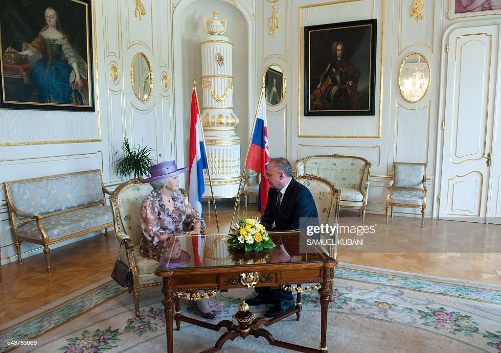 Princess Beatrix of The Netherlands (L) and Slovak President Andrej Kiska chat prior to their meeting at the presidential palace in Bratislava on June 30, 2016. Netherland's hands over to Slovakia the rotating six-month Presidency of the European Union Councilof on July 1, 2016. / AFP / SAMUEL