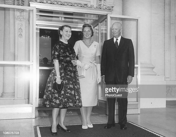 Princess Beatrix of the Netherlands poses with US President Dwight Eisenhower and First Lady Mamie Eisenhower at the White House while on a royal...