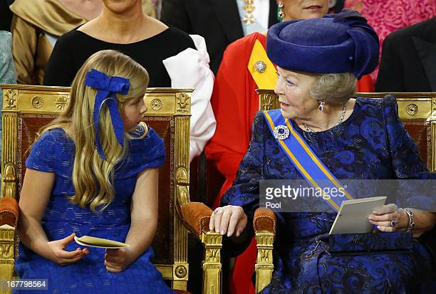 Princess Beatrix of the Netherlands sits with her granddaughter Princess CatharinaAmalia of the Netherlands during the inauguration of HM King...