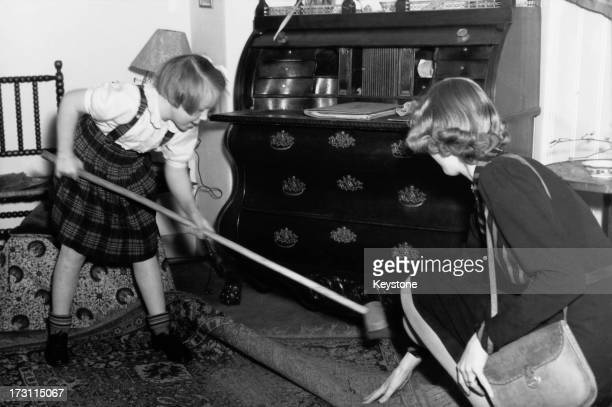 Princess Beatrix of the Netherlands sweeping up at her primary school 'De Werkplaats' in Bilthoven Netherlands 1946
