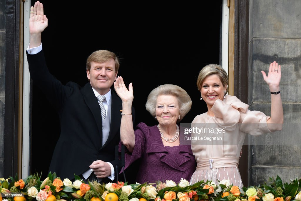 Princess <a gi-track='captionPersonalityLinkClicked' href=/galleries/search?phrase=Beatrix+of+the+Netherlands&family=editorial&specificpeople=92396 ng-click='$event.stopPropagation()'>Beatrix of the Netherlands</a> with HM King Willem Alexander (L) and HM Queen Maxima (R) appear on the balcony of the Royal Palace to greet the public after her abdication and ahead of the Inauguration of King Willem Alexander of The Netherlands on April 30, 2013 in Amsterdam, Netherlands.