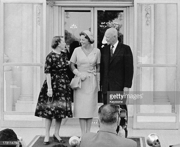Princess Beatrix of the Netherlands with US President Dwight D Eisenhower and First Lady Mamie Eisenhower posing for photographers on the north...
