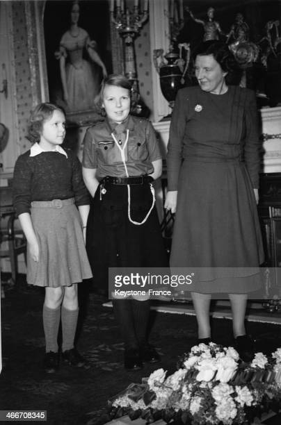 Princess Beatrix when she became twelve years old left Princess Irene and right Queen Juliana in 1950 in Netherlands