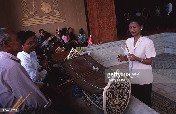 Princess Bopha Devi Minister of Culture and former apsara is also the director of the Royal Ballet of Cambodia She is talking with the musicians of...
