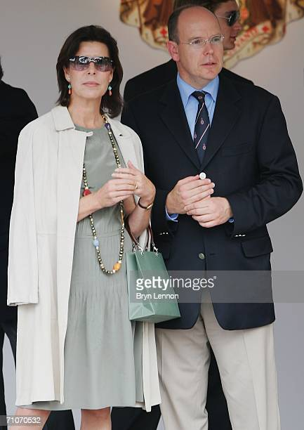 Princess Caroline of Hanover and her brother Prince Albert II of Monaco wait on the podium to present trophies to the winning drivers after the...