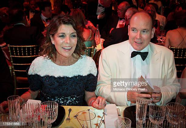 Princess Caroline of Hanover and Prince Albert II of Monaco attend the 65th Monaco Red Cross Ball Gala at Sporting MonteCarlo on August 2 2013 in...